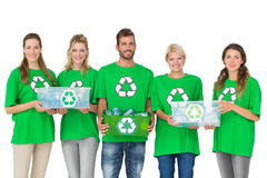 People in recycling symbol tshirts carrying boxes. Group portrait of young people in recycling symbol tshirts carrying boxes over white background Stock Photo