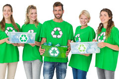 People in recycling symbol tshirts carrying boxes Stock Photo