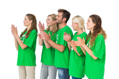 People in recycling symbol tshirts clapping hands. Side view of young people in recycling symbol tshirts clapping hands over white background Royalty Free Stock Image
