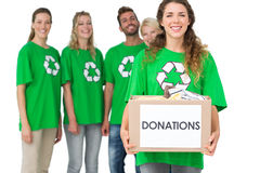 People in recycling symbol tshirts with donation box. Group portrait of young people in recycling symbol tshirts with donation box over white background Stock Photo