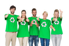 People in recycling symbol tshirts gesturing thumbs up. Group portrait of young people in recycling symbol tshirts gesturing thumbs up over white background Stock Photos
