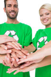 People in recycling symbol tshirts with hands together. Portrait of young people in recycling symbol tshirts with hands together over white background Royalty Free Stock Images