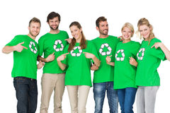 People in recycling symbol tshirts pointing to themselves. Group portrait of young people in recycling symbol tshirts pointing to themselves over white Stock Photography