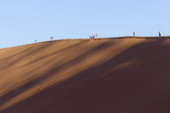 People on a red dune in the Namib Desert, in Sossusvlei, Namibia Royalty Free Stock Image