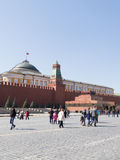 People in the Red Square and Lenin's Mausoleum. Moscow - April 12 2015: Lenin's Mausoleum on Red Square, and people walk and see the sights at the Kremlin April Royalty Free Stock Photography