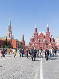 People in Red Square. Moscow - April 12, 2015: A lot of people walk and see the sights on Red Square in the early spring weather is nice, April 12, 2015, Moscow Stock Images