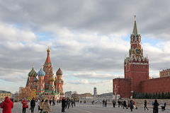 People at Red Square with Saint Basil Cathedral. MOSCOW - OCT 22: People at Red Square with Saint Basil Cathedral and Spasskaya Tower in Moscow on October 22 Royalty Free Stock Images