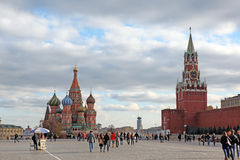 People at Red Square with Saint Basil Cathedral. MOSCOW - OCT 22: People at Red Square with Saint Basil Cathedral and Spasskaya Tower in Moscow on October 22 Stock Photo