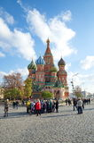 People in red square before St. Basil, Moscow, Russia. Moscow, Russia - October 24, 2016: Tourists near St. Basil`s Cathedral Cathedral of the Intercession of Stock Photography