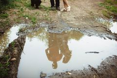 People reflected in a puddle royalty free stock photo