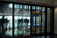 People reflection. S in a building glass doors. Top floor Royalty Free Stock Image