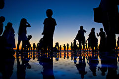 People reflections on colorful sunset Stock Images