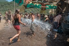 People refresh with water from a cistern on the main stage the Lost Theory psytransce music festival