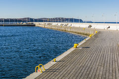 People refreshment on the waterfront at the Sopot Pier. Royalty Free Stock Photo