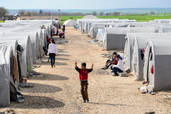 People in refugee camp. Syrian people in refugee camp in Suruc. These people are refugees from Kobane and escaped because of Islamic state attack. 30.3.2015 Royalty Free Stock Photo
