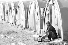 People in refugee camp. Syrian people in refugee camp in Suruc. These people are refugees from Kobane and escaped because of Islamic state attack. 3.4.2015 Royalty Free Stock Photography