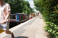 People on the Regent's Canal walkway. Royalty Free Stock Photo