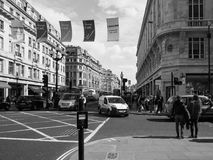 People in Regent Street in London black and white