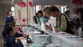 People register to international exhibition stock footage