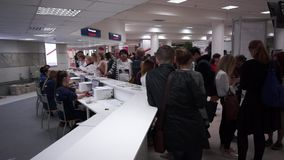 People register to international exhibition stock video footage