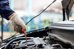 Hand holding is check oil engine. royalty free stock photography
