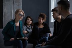 People in rehab center. Young people in rehab center on group psychotherapy Royalty Free Stock Photo