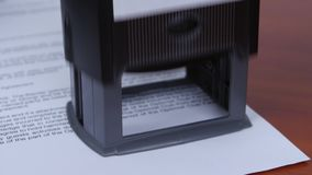 People rejected conditions of the contract by the rectangular stamp. Close up stock video