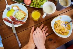 Couple hands on table full of food Royalty Free Stock Image