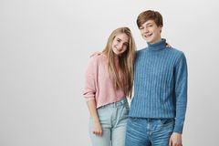 People, relationships, leisure, and lifestyle. Charming young hipster couple enjoying free time, looking happy and Royalty Free Stock Photos
