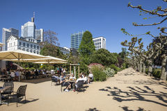 People relax at the bank of river Main in Nizza gardens Stock Photography