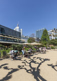 People relax at the bank of river Main in Nizza gardens Royalty Free Stock Images