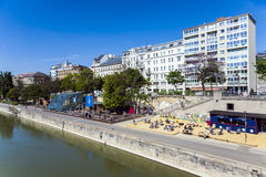 People relax at the beach of the Danube canal in Vienna Royalty Free Stock Photo