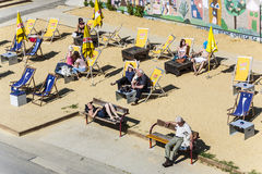 People relax at the beach of the Danube canal in Vienna Royalty Free Stock Photography
