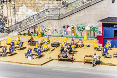 People relax at the beach of the Danuvia canal in Vienna Stock Photography