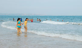 People relax on the beach in Nha Trang, Vietnam Stock Images