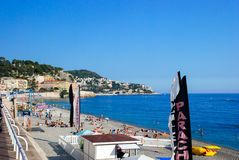 People relax on the beaches of Azure coast in Nice, France. Stock Images
