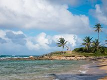 People relax on a beautiful beach in San Juan, Puerto Rico, on a warm and sunny day. San Juan, Puerto Rico. December 28, 2018. People relax on a beautiful beach stock images