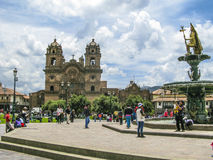 People relax at at Central square Plaza de Armas in Cuzco, Peru. Stock Images