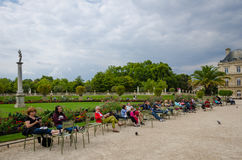 People relax in chairs in the beautiful Luxembourg Gardens Stock Photography
