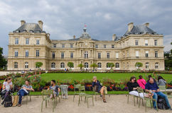 People relax in chairs in the beautiful Luxembourg Gardens Royalty Free Stock Photos