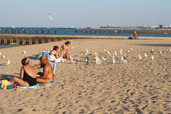 People relax on Chicago Uptown beach Royalty Free Stock Image