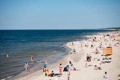 People relax at city beach on Baltic Sea coast Royalty Free Stock Images