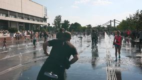 People relax in the city in celebration around the fountains and park on the streets of Moscow stock video