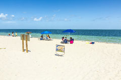 People relax at the Crandon Park beach Stock Image