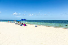 People relax at the Crandon Park beach Stock Images