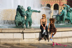 People relax at the Fontaine du Soleil at the Place Massena square on a hot day in Nice, France. Royalty Free Stock Photography