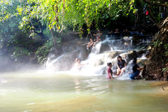 People relax in a hot spring waterfall near Krabi, Thailand Royalty Free Stock Images