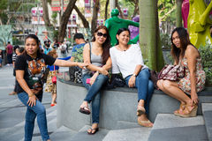 People relax at the ION Orchard in Singapore Royalty Free Stock Image