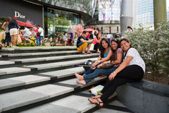 People relax at the ION Orchard in Singapore Stock Image