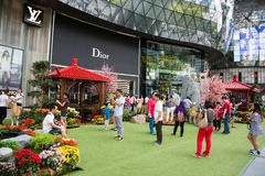 People relax at the ION Orchard in Singapore Royalty Free Stock Photos